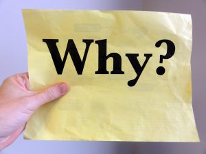 "Yellow paper saying ""Why?"""