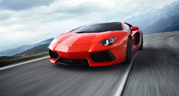 Mountain Back Drop and Red Lamborghini Aventador