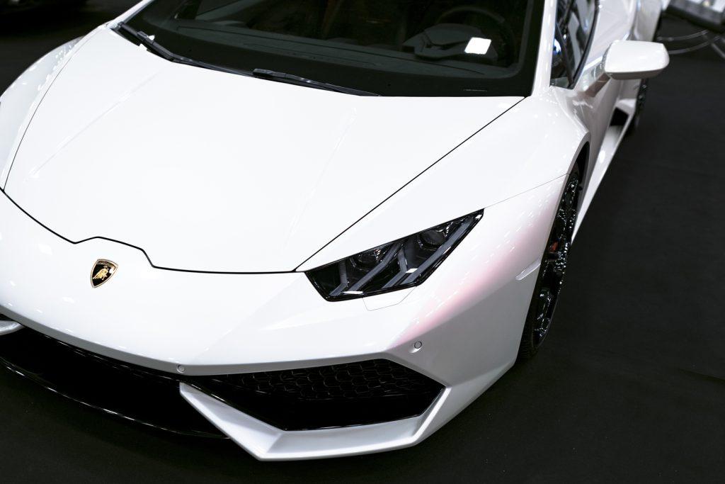 Front view of a White Luxury sportcar Lamborghini Huracan LP 610-4. Car exterior details. Photo Taken on Royal Auto Show July 21